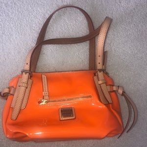 Dooney and Burke small tangerine purse